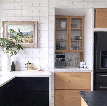 black kitchen cabinet idea for modern kitchen with white subway tile walls