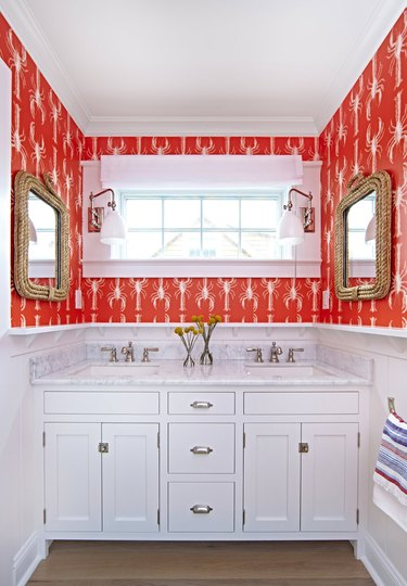colors that go with red in a red and white bathroom with lobster print wallpaper