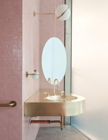 gold bathroom sink idea in pink bathroom