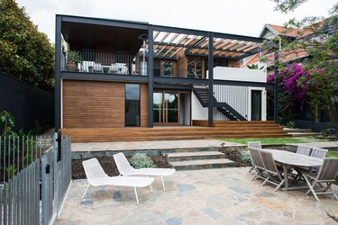 deck stairs ideas on two-story house with large back patio