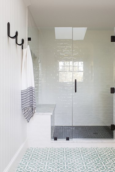 modern shower idea with matte black hardware and cement tile in modern bathroom shower
