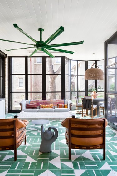 carpet tiles in green and white carpet colors in outdoor living space with green ceiling fan