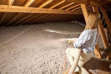 Blowing insulation in the attic.