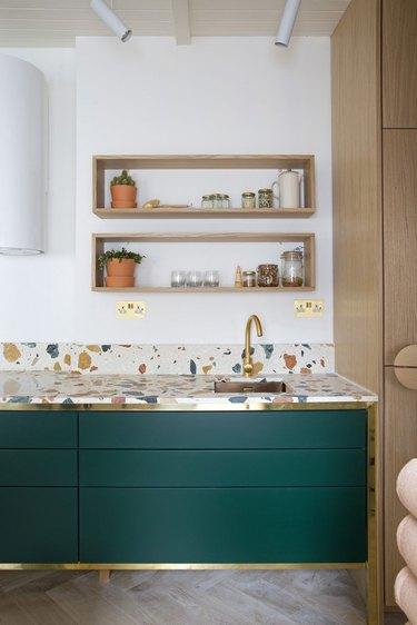modern kitchen backsplash idea with oak cabinetry and terrazzo countertop