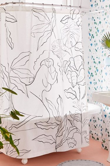 bathroom shower curtain idea with black and white figures and plants