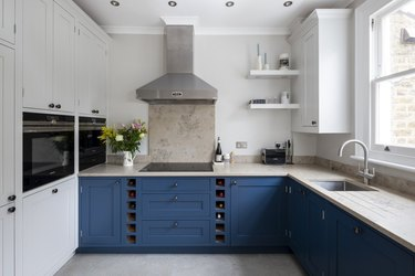 natural limestone with blue cabinets