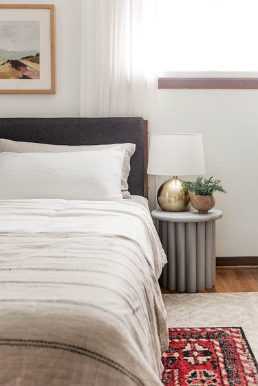 This gray ribbed side table looks exactly like the West Elm version but is $138 cheaper to make.