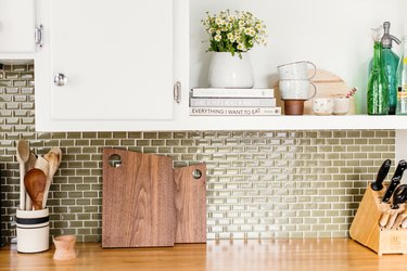 Kitchen counter with cutting boards and utensils