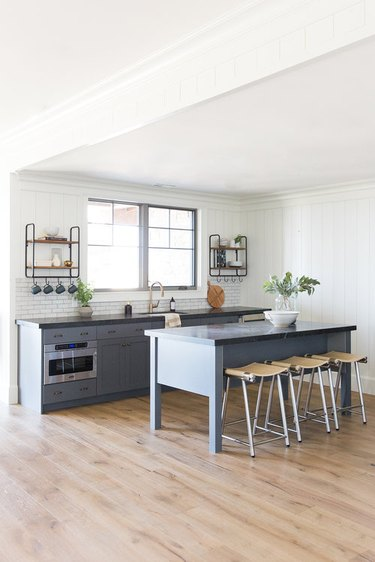 small kitchen island idea with gray cabinets and black countertop with subway tile backsplash