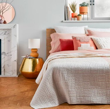 bed with pink pillows