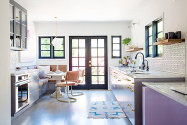 Artistic midcentury kitchen lighting idea with purple cabinets
