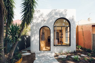 small white traditional stucco homes with arched windows
