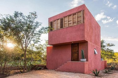 pink traditional stucco homes with two levels