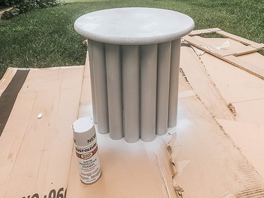 Spray paint the constructed table a uniform gray color to match the inspiration piece.