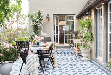 beige traditional stucco homes and back patio with blue floor tile