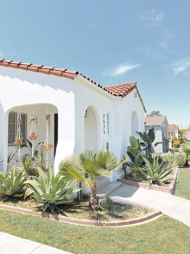 white traditional stucco homes with red roof and desert landscaping