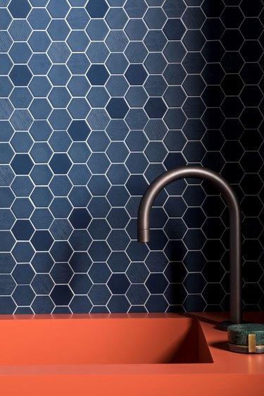 blue hex mosaic kitchen backsplash with coral sink