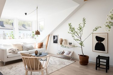 attic living room with Scandinavian-inspired attic with muted colors