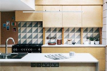 birch midcentury modern kitchen backsplash idea with monochrome mid-century modern backsplah