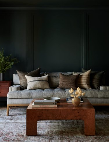 living room with gray couch and coffee table with cool colors