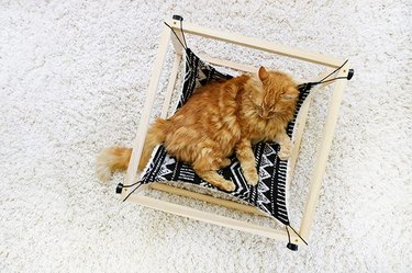 DIY kitty hammock made with wood and double-sided fabric