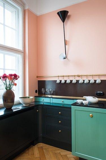 black kitchen backsplash in pink and green kitchen