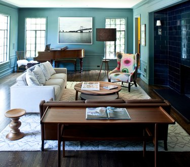 living room with couch, piano, and teal cool colors