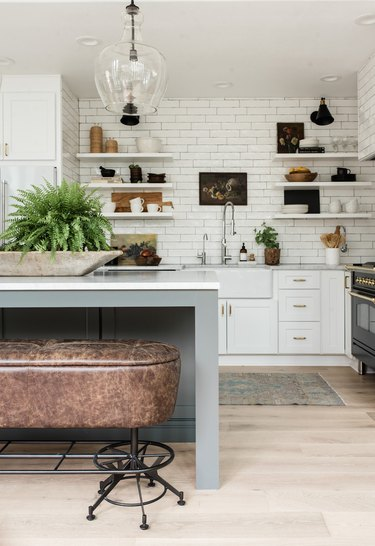 Industrial farmhouse kitchen with leather bench and subway tile backsplash