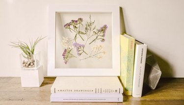 Pressed flowers housed in a pretty, minimal frame