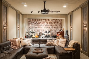 Fathers Day man cave idea with brick accent wall and stage for performing instruments