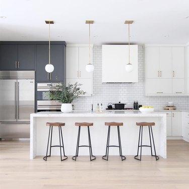 kitchen island lighting idea with globe-style pendants