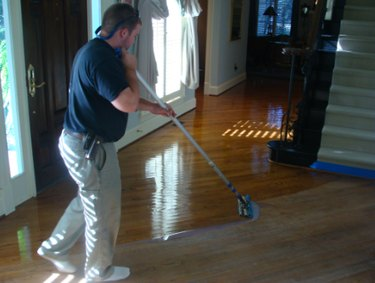 Finishing a hardwood floor.