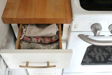 small kitchen organization idea with Marie Kondo folding technique