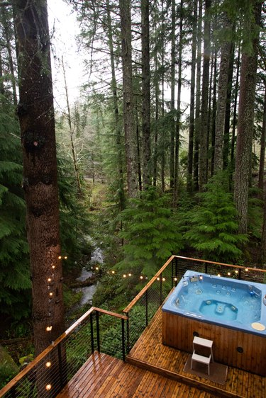 New decks and railings lead to the hot tub.