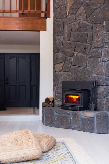 The two story stone fireplace in the family room.