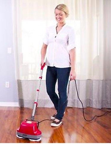 Polishing a hardwood floor.