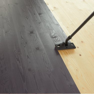 Painting a wood floor.