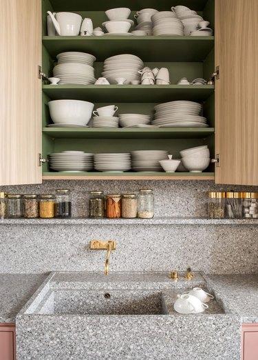 modern kitchen backsplash idea with gray terrazzo countertops and open shelving