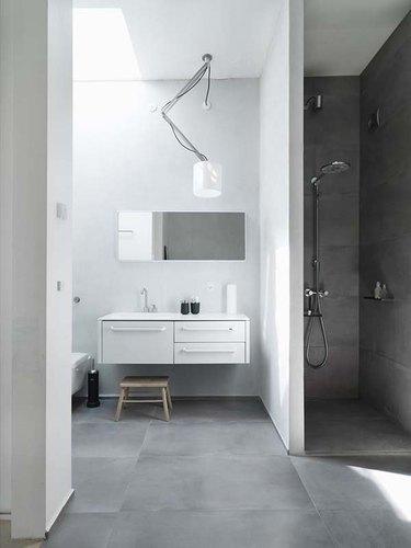 A dark concrete shower