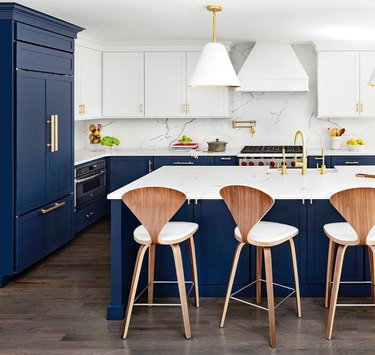navy cabinets kitchen trend in 2019 with white cabinets and marble backsplash
