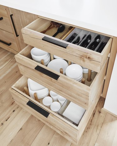 small kitchen organization idea with peg system dividing drawers