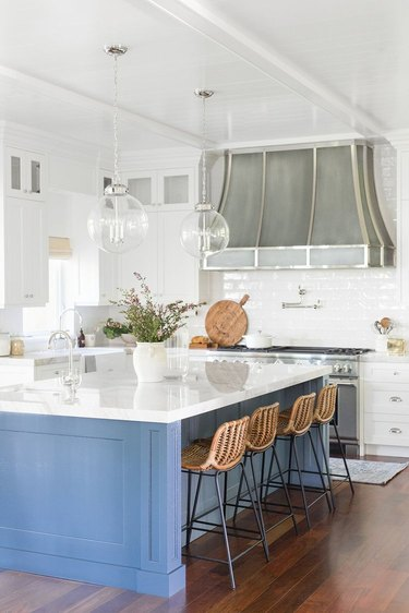blue and white kitchen trend in 2019 with large island and white subway tile backsplash