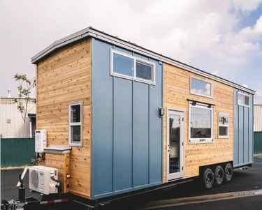 Tiny home with blue board and batten exterior siding
