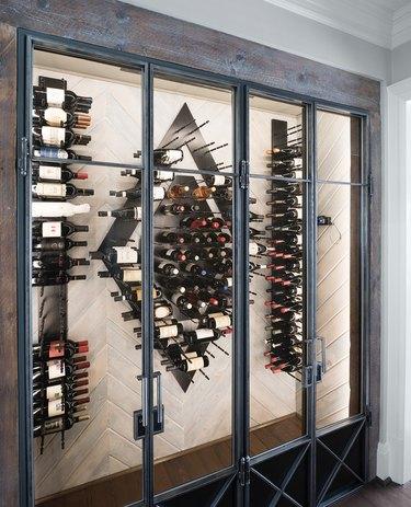 Industrial metal and wood wine cellar in industrial basement