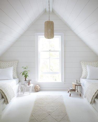 white boho attic bedroom lighting ideas with shiplap ceiling