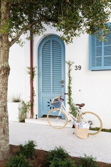 exterior door trim on mediterranean house with blue front door and trim