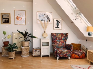 room with attic skylight designs, disco ball, and floral wingback chair