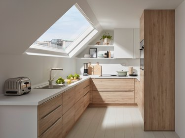 white attic kitchen and big skylight