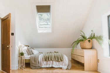 attic skylight designs in bedroom with sloped ceiling