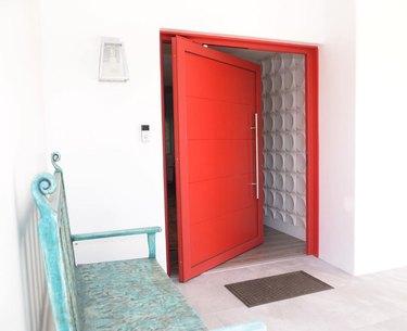 pivoting modern exterior door in red